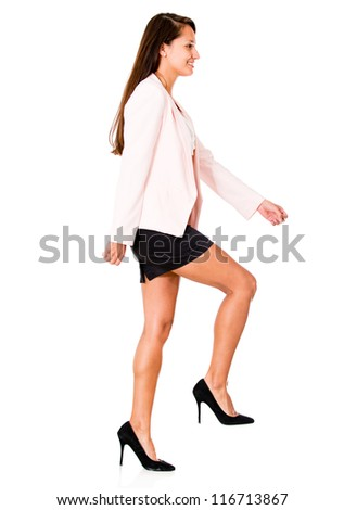 Business woman climbing stairs - isolated over a white background - stock photo