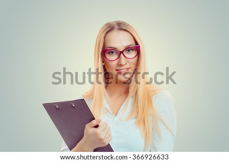 Business woman Closeup portrait headshot serious confident businesswoman holding clipboard looking at you isolated green yellow wall background white shirt Human face expression body language attitude - stock photo