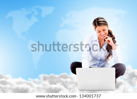 Business woman cloud computing looking very happy using wireless technology - stock photo