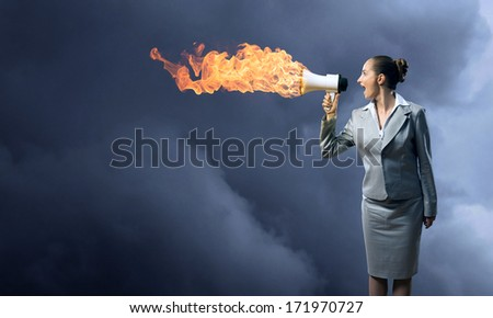 business woman cooks shouting into a megaphone, megaphone fire - stock photo