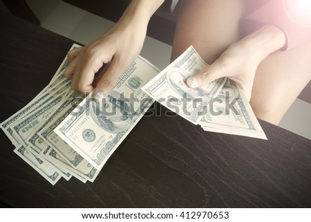 business woman counting money with morning light, financial concept , business idea , business concept - stock photo