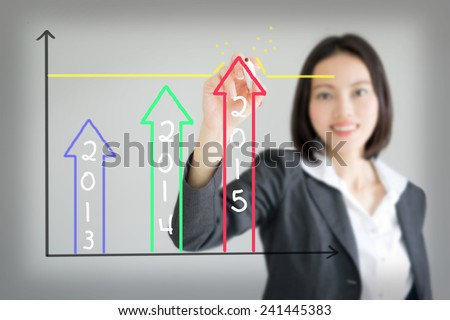 business woman drawing over target achievement graph - stock photo