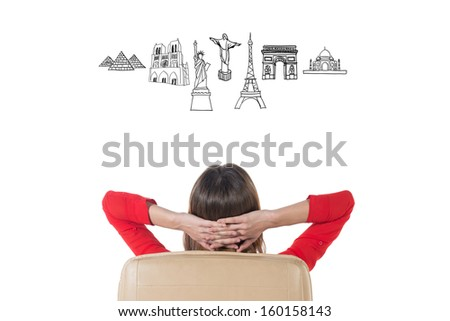 Business woman dreaming of her trip to famous touristic destination. Architecture symbols overhead  - stock photo