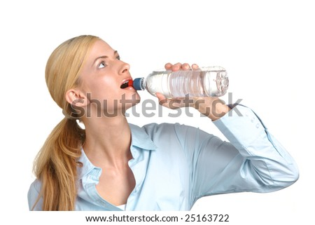 Business woman drinking water from a bottle - stock photo