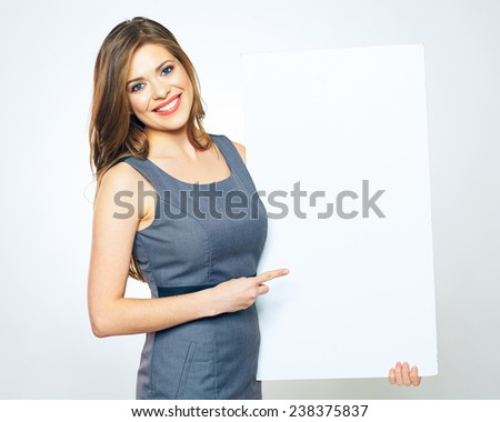 business woman finger pointing on blank sign board. smiling female business model with long hair. - stock photo