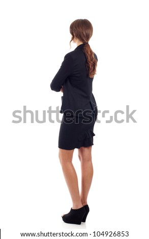 Business woman from the back, looking at something isolated over white background - stock photo