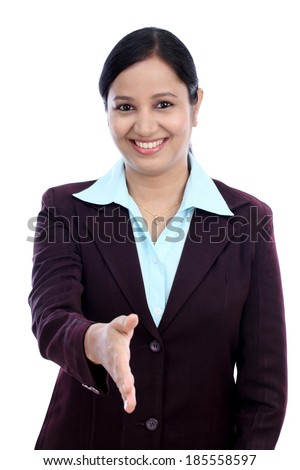 Business woman giving hand shake against white background - stock photo
