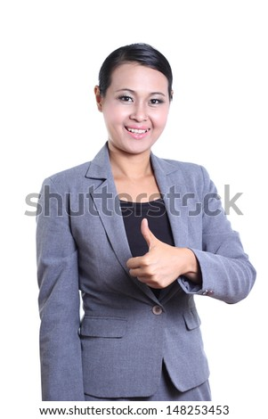Business woman giving the thumb up - stock photo