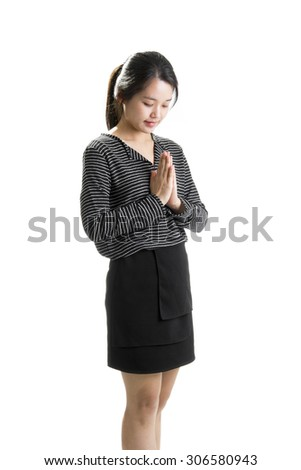 Business woman greeting with Thai culture SAWASDEE - stock photo