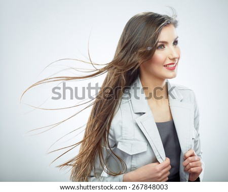 Business woman. Hair in motion. Isolated girl portrait. - stock photo