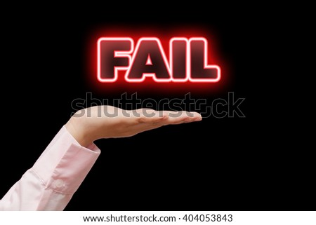 Business woman hand cupped holding the word FAIL with red neon light - stock photo