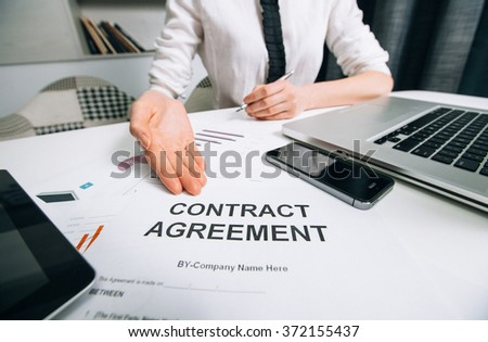 Business woman handing over a contract for signature offering - stock photo
