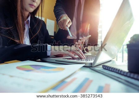 Business woman hands using laptop and holding credit card with digital business layers diagram as Online shopping concept in morning light. vintage effect - stock photo