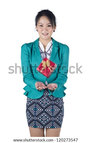 Business woman happy smile, gift box falling down into hands. Motion blur, Isolated over white background. Model is Asian woman. - stock photo