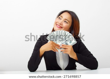 business woman happy with many banknote - stock photo