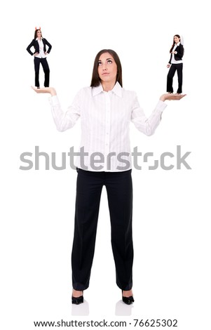 business woman has a devil in one hand and an angel in the other - stock photo