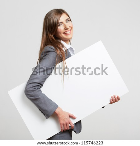 Business woman hold white blank paper. Young smiling girl  show blank board. Female model portrait isolated on white background. - stock photo