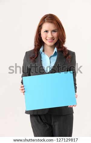 business woman holding a blank blue cardboard - stock photo