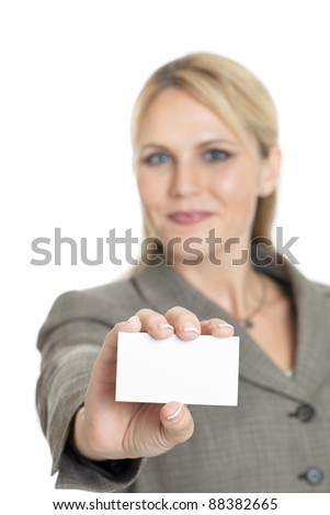 Business woman holding a blank business card isolated on a white background - stock photo