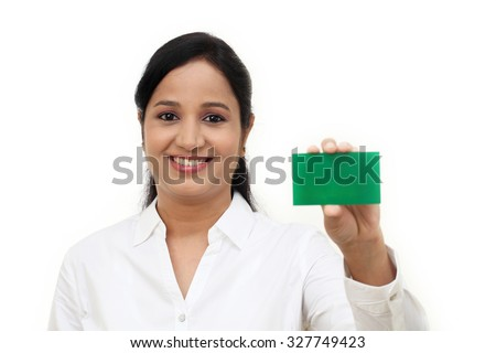 Business Woman holding a blank card against white background - stock photo