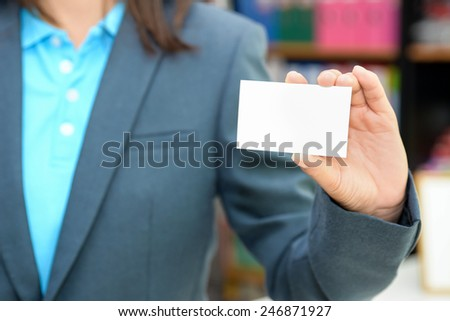 Business woman holding a business card  - stock photo