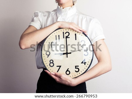 Business woman holding a clock - stock photo