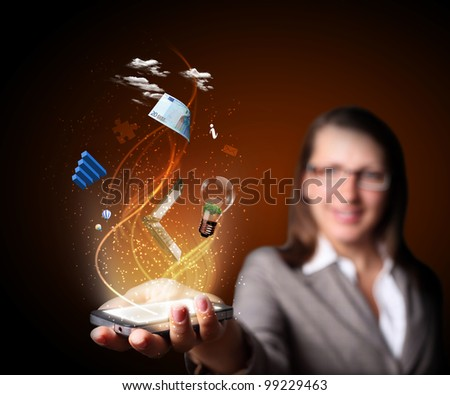 Business woman holding a mobile phone sending images - stock photo