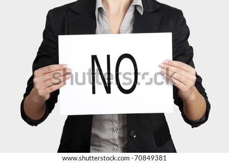 Business woman holding a paper card with the word NO - stock photo