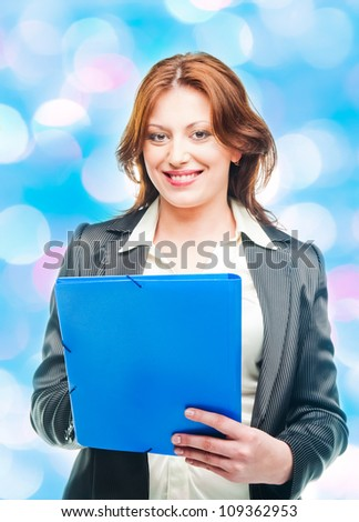 business woman holding a portfolio - stock photo