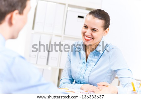 business woman holding an interview with a man in the office - stock photo