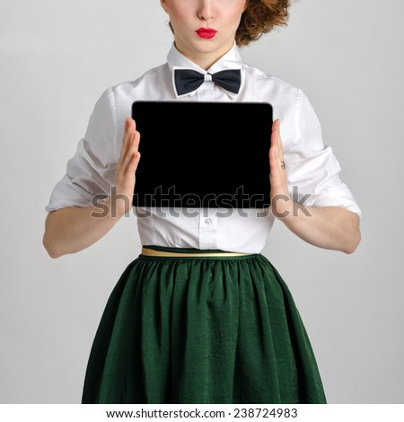 Business woman holding and shows touch screen tablet pc with blank screen. - stock photo