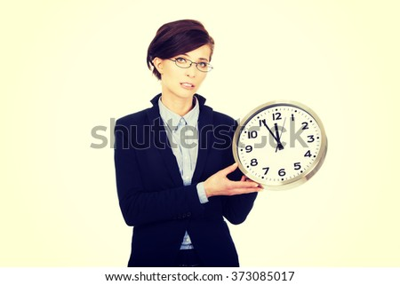 Business woman holding clock in hands. - stock photo