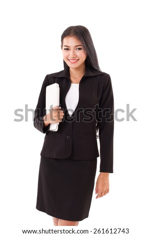 business woman holding computer tablet or touchpad - stock photo