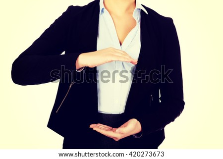 Business woman holding empty copy space between her hands - stock photo