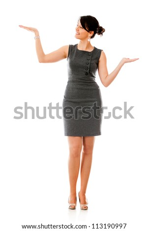 Business woman holding something in her hand - isolated over white background - stock photo
