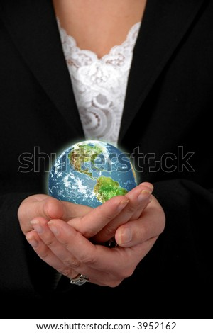 Business woman holding the earth - stock photo