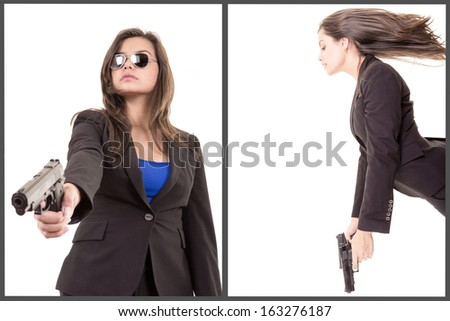 business woman holding up her weapon - stock photo