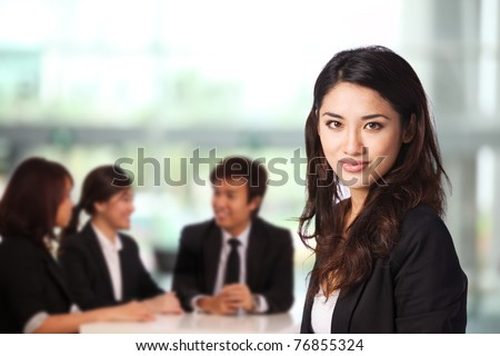 Business woman in a corporate environment - stock photo