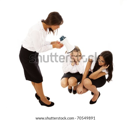 business woman in black skirt and white blouse shouting through a megaphone at two others - stock photo