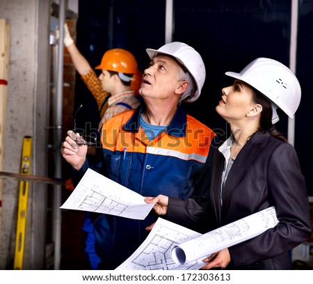 Business woman in builder helmet indoor. - stock photo
