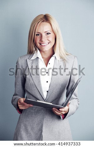 Business woman in gray suit with folder - stock photo