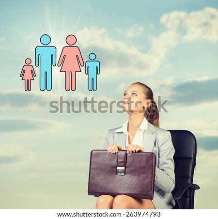 Business woman in skirt, blouse and jacket, sitting on chair imagines family. Against background of sky and clouds - stock photo