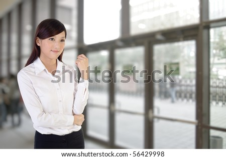 Business woman indoor, closeup portrait of Asian inside building of office. - stock photo