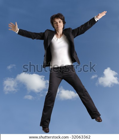business woman jumping in the air - stock photo