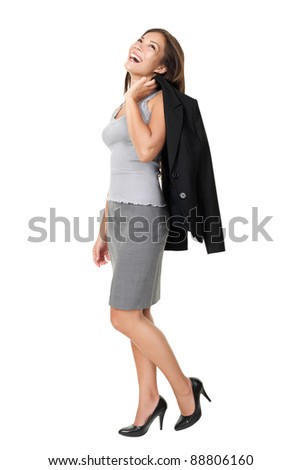 business woman laughing standing isolated on white background in full length. Beautiful joyful happy mixed race Chinese Asian / white Caucasian female model. - stock photo