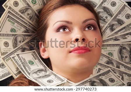 Business woman laying in money. - stock photo