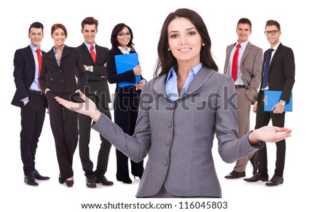 business woman leader welcoming to her successful team - stock photo