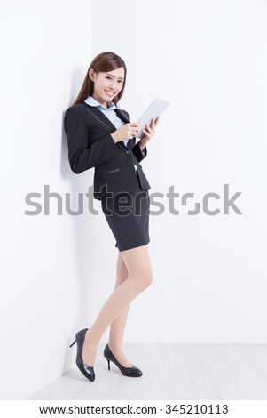 business woman lean wall and use digital tablet pc with white wall background, great for your design or text, asian - stock photo