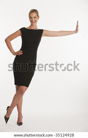 business woman leaning on copy space on white seamless background - stock photo