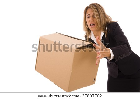 Business woman let falling a cardboard box - stock photo